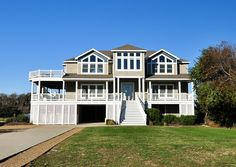 $1803 (5) -- Ocean's 10 - J20968 is an Outer Banks Semi-Oceanfront vacation rental in Whalehead Corolla NC that features 10 bedrooms and 10 Full 1 Half bathrooms. This rental has a private pool, an elevator, and a pool table among many other amenities. Click here for more. Oceanfront Vacation Rentals, Vacation Home Rentals, Beach Cottages, Beach Houses, Beach Cottage Exterior, Outer Banks Vacation, Corolla 2018, Beautiful Places, Half Bathrooms