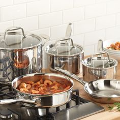 "Stainless Cookware 8-Piece Set - The Pampered Chef®  Set includes: 8-qt. Covered Stockpot, 3-qt. Covered Saucepan, 1.5-qt. Covered Saucepan, 10"" Skillet and 8"" Sauté Pan. Stockpot and saucepans have glass lids; stockpot lid fits skillet. All pieces except sauté pan have measure marks."