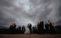 Dramatic wedding party portrait with dark cloudy and stormy skies at Arbor Crest Winery photo by Matt Shumate Photography