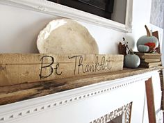 A Thanksgiving themed mantel - creating a sign using a marker and a pallet board #DIY #pallet FREE! $0