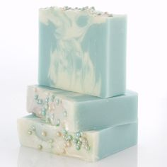 This soap is called First Frost - icy cool blue with wisps of frosty white topped with glitter and blue and white sugar pearls. Scented with a crisp essential oil blend of juniper berry, cypress, Siberian fir, and pink grapefruit.