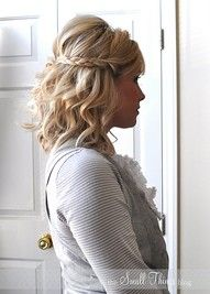 Cute!  Curl in big loose curls, tease the crown, braid the sides, and secure in back.