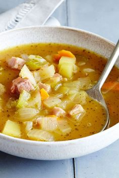 This pumpkin soup recipe incorporates onions, carrots, celery, apples, dry white wine, bay leaves and ham to create the ultimate comfort food meets fall recipe. Whether you're eating this pumpkin recipe as a cozy weeknight dinner or packing it for a fall lunch, it's a great choice for a soup recipe. #fallrecipes #comfortfoods #pumpkinrecipes #pumpkinsoup #souprecipes #pumpkinsouprecipes