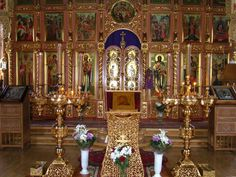 Religion: This is a picture of a Russian orthodox inside. In russian orthodox churches the people stand while the preist chants. The service takes two or more hours. There are pictures to tell lessons of faith. Inside the church it smells from the sweetness of burning incense that are in medal containers.