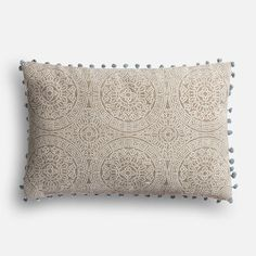 It may not be red, but it sure is a gem! Part of the Magnolia Home Collection by Joanna Gaines, the Ruby pillow boasts an eye-catching, kaleidoscopic design in muted gray and slate hues that allow it to travel from room to room. For the finishing touch, a trim of whimsical pompoms travel from corner to corner.