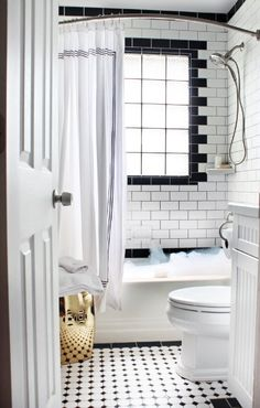Check out this super cool black and white bathroom with stunning subway tiles.