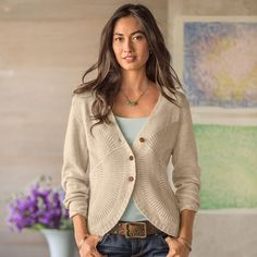 """MEDALLION CARDIGAN--Fan stitch medallions emanate from side seams, shaping the waistline on our V-neck cardigan. Soft blend of viscose/polyester/nylon and angora. Hand wash. Imported. Sizes XS (2), S (4 to 6), M (8 to 10), L (12 to 14), XL (16). Approx. 25""""L in back."""