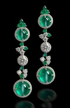 A pair of cat's eye emerald and diamond pendent earrings
