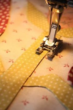 """INVISIBLE MACHINE APPLIQUE = Blogger wrote: """"Great time to stay home and applique... I'm doing the invisible machine applique method I blogged about in May of 2009. (Click on the date to find the post.) ...I use an open toe presser foot. It opens my field of vision... I need to see my exact needle placement..."""""""