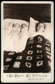 victorian death photo of mother and triplets that died in childbirth--baby closest to mother looks like it may be alive---color is different
