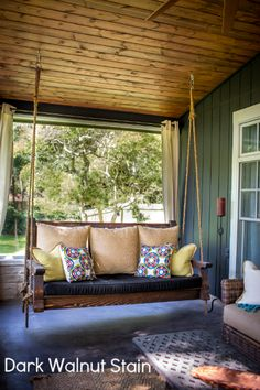 What could be more complimentary to an entryway patio than a wooden porch swing? Bring back the charitableness of times past. A porch swing can add a dash of sentimentality to the front of your home. Farmhouse Front Porches, Modern Farmhouse Exterior, Rustic Porches, Southern Front Porches, Outdoor Spaces, Outdoor Living, Outdoor Decor, Outdoor Privacy, Outdoor Kitchens