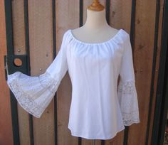 Boho Chic. ..     https://www.etsy.com/listing/243829230/vintage-1960s-white-lace-bell-sleeve