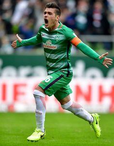 Zlatko Junuzovic of Bremen celebrates after scoring his teams first goal during the Bundesliga match between Werder Bremen and RB Leipzig at Weserstadion on March 18, 2017 in Bremen, Germany.
