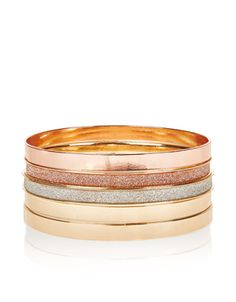 Create a luxe aesthetic with this set of five mixed bangles, featuring gold- and rose gold-tone metal, and glittery designs.