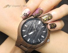 @jordwoodwatches Fieldcrest in Dark Sandalwood with an inspired #mani/ #nailart with real gears/ cogs. More details and tons more #photos on http://www.alacqueredaffair.com/Jord-Wood-Watch-Floral-Cogs-Mani-38551780 Polishes used (and matted): • @picturepolish Douceur and Ornate • #OPI My Private Jet and Black Onyx #nails #jordwatch