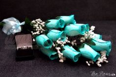 click here to check out our baby blue wax dipped roses!