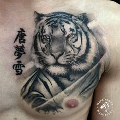 Chronic Ink Tattoo - Toronto Tattoo Healed tiger tattoo by guest artist, Janice.