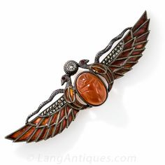 Egyptian Revival Sterling Silver Scarab Brooch 1920s depicts a scarab (the ancient Egyptian symbol of Ra the sun god). The scarab is carnelian