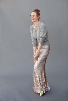 Shop this look on Lookastic:  http://lookastic.com/women/looks/sunglasses-necklace-crew-neck-sweater-maxi-skirt-pumps/5468  — Gold Sunglasses  — Gold Necklace  — Grey Crew-neck Sweater  — Gold Sequin Maxi Skirt  — Gold Leather Pumps