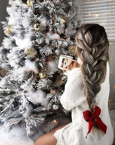 This hair though.... love the bow at the end of the braid! What a GREAT idea for the holidays! oh... and that Christmas tree though ...