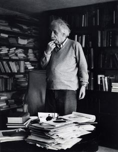German born physicist who formulated the theories of relativity, Albert Einstein - ponders a problem in his paper-filled study in Princeton, New Jersey. A Nobel prize-winner for Physics in Original Publication: In black and white book Theory Of Relativity, E Mc2, Physicist, Belle Photo, New Jersey, South Beach, Black And White Photography, Old Photos, Rare Photos