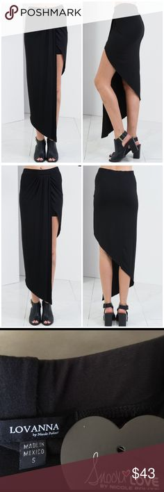 Asymmetrical Knit Skirt Contemporary super soft asymmetrical skirt from the Lovanna line of Nicole Polizzi .  Features an asymmetrical hem , flowing fabric and an elasticized waist .  Made of rayon/spandex .  Machine washable . Nicole Polizzi Skirts Asymmetrical