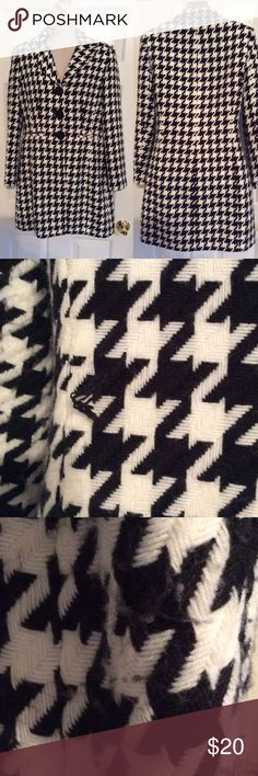 Knee length black and white houndstooth fall coat In good condition. A small snag on back in photo 2 could be trimmed and likely not noticeable. Has some pilling under arms and where arms rubbed on body of jacket. Can be removed with scissors. Otherwise no stains or holes. Is lined. Outside material is acrylic. Lining is polyester. Not super warm. Likely best for fall and spring unless you live in a warmer climate where it is not too cold in winter. Signature by Larry Levine Jackets & Coats