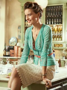 Teal cardigan with cream lace pencil skirt, thin belt at waist