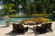 double chaise lounge Patio Traditional with beige outdoor cushions boulders