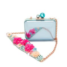 Stunning metallic aqua leather Minaudiere of Sophie Webster, finished with sequin flower detail on strap. Embellished with spearmint and turquoise ball detail and rose gold chain.