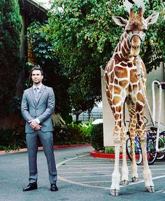 Now that's about as perfect as it gets! Adam Levine and a giraffe! Love, love this!!!