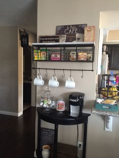 Coffee and Tea station in the home, i really really like the hanging bar with the side table