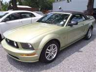 light green Mustang convertible with white interior, want one