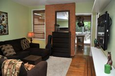 This Hamilton home that the Walsh and Volk Re/Max team just listed has great character featuring brick wall in living room.  http://www.walshandvolk.com/256-holton-avenue-south-hamilton/