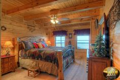 I love this cozy, cabin bedroom