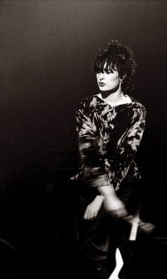 Siouxsie Sioux performing live on stage at Manchester Apollo, photographed by Martin O'Neill, 1980