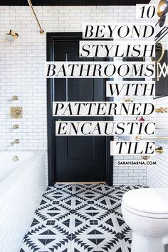 Bathroom with subway tile, black doors, gold hardware, and patterned encaustic tile floor, designed by Katie Martinez, via @sarahsarna.