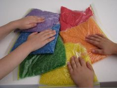 Rainbow Rice Bags. She used jasmine rice, which added a nice smell to the sensory experience.