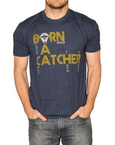 Catchers aren't made, catchers are born. Premium navy poly cotton material makes for a soft and light fitting designer tee. The vintage Baseballism Bat Logo is screened with detail on the back right o