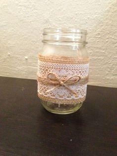 Burlap, lace, and twine mason jar candle holder or vase. Rustic wedding decor.
