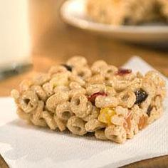Carla Hall for Country Crock    On-the-Go Bars    Ingredients1/3 cup Country Crock Spread 1 bag (10 oz.) marshmallows 1/2 tsp. ground cinnamon 6 cups toasted O-shaped whole grain oat cereal 1 bag (7 oz.) dried mixed fruit bits     Directions Line