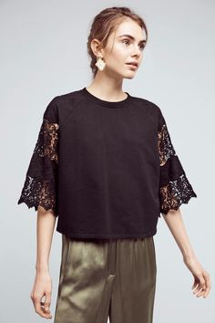 This cropped lace sweatshirt exudes sophistication.