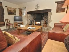 Cosy lounge with slate floors, inglenook fireplace and woodburner