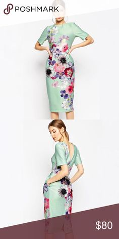 ASOS Floral Wiggle Dress Printed fabric, Textured finish, Round neckline, Fitted waist seam, Side pockets, V-shaped back, Zip back closure, Kick split, Slim fit - cut closely to the body. PRICE FIRM! ASOS Dresses Midi