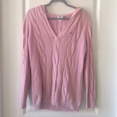 Pink hooded Lacoste sweater Cable knit pink Lacoste sweater. Great condition! V-Neck and hooded. Size 42 which is equivalent to a woman's XL Lacoste Sweaters