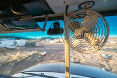 "Outside Found ""Skoolie"" school bus conversion Driver's Area – fan & tiny dash cam."