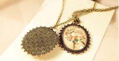 Graceful vintage style antique bronze floral pendant.