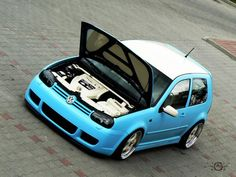 Volkswagen Golf in cyan color modified with white roof top and projector headlights . This golf is dropped and sticker work is done o. Volkswagen Golf Mk1, Volkswagen Models, Golf 4, Vw Golf Variant, Cool Roof, Modified Cars, Hot Cars, Rooftop, Wheels