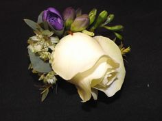 rose buttonhole with freesia and astranthia www.weddingflowersbylaura.com