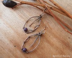 Beautiful leaf earrings made of copper wire and purple howlite beads. Length of earrings (including ear wires) is 2.56 in (6,5 cm). Wire is antiqued and protected from further tarnishing with shellac.   If you have any questions about this product please contact us. With purchasing any item in our shop you get surprise gift.  We accept pay pal We are ready to ship your order in 1-3 days after payment Here you can check other earrings in our shop https://www.etsy.com/shop/d...